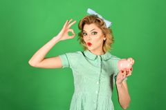 Family budget, bankruptcy and handout. Family budget, pinup housewife save money with ok gesture stock photos