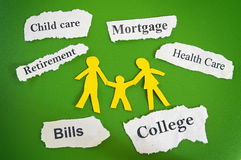 Family budget concept. Paper cutout family with expense messages on torn paper scraps royalty free stock images