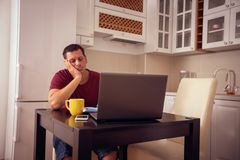 Family budget and finances- man counting and checking household daily expenses. Family budget and finances- young man counting and checking household daily royalty free stock images