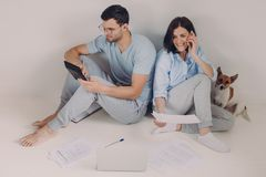 Family budget, payment, finances concept. Family couple analyze documents together, calculate expenses, use calculator, laptop stock photos