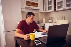 Family budget planning - man counting and checking household daily expenses. Family budget planning – young man counting and checking household daily royalty free stock image