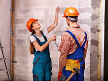 Family in builder uniform indoor. Stock Photography
