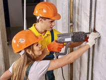 Family in builder uniform indoor Stock Photo