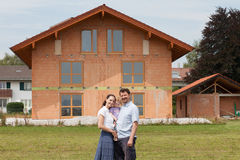 Family building a house - real estate Royalty Free Stock Photography