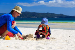Family building sandcastle Stock Image