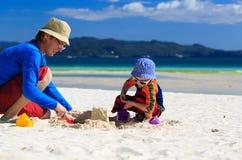 Family building sandcastle Stock Image