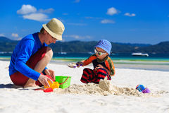 Family building sandcastle Stock Photos