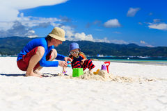 Family building sandcastle Royalty Free Stock Images