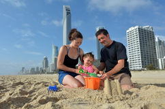Family builds sand castle in Surfers Paradise Australia Royalty Free Stock Photos