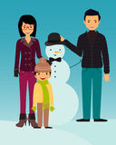 Family builds snowman Royalty Free Stock Photo