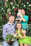 Family with bunch of flowers in garden Royalty Free Stock Photos