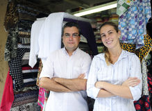 Family business partners owners of a fabric store. Proud family business partners owners of a fabric store Royalty Free Stock Images