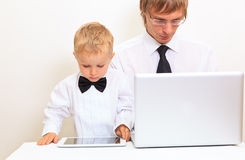 Family in business style working at home Royalty Free Stock Images