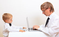 Family in business style working at home Stock Photography