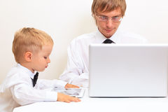 Family in business style working at home Stock Photos