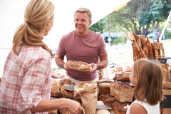 Family Buying Bread From Bakery Stall At Farmers Market Stock Photo