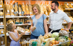 Family buying bread in food store Royalty Free Stock Photo