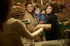 Family buying bread Royalty Free Stock Photography