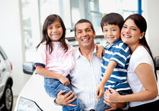 Family buying a car Royalty Free Stock Images