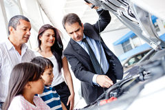 Family buying a car Stock Photography