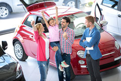 Family buying a car Stock Photos