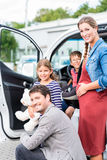 Family buying car, mother, father and child at dealership Stock Photo