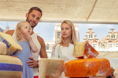 Family buying cheese at the outdoor market. Family buying traditional Dutch  cheese at the local  outdoor market Stock Photo