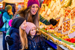 Family buying on Christmas market decoration Stock Images