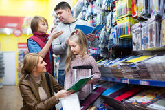 Family buying copy-books Stock Photo
