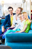 Family buying couch in furniture store Stock Photo