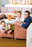 Family buying couch in furniture store Royalty Free Stock Image