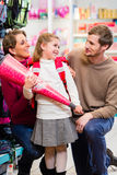 Family buying first day in school candy cone Stock Photo