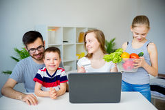 Family buying food online. Happy family buying food online with laptop stock image