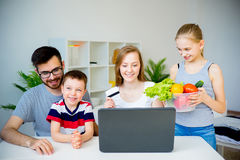 Family buying food online Stock Photography