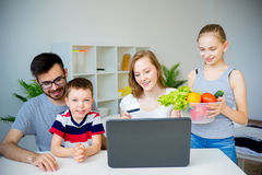 Family buying food online Royalty Free Stock Image