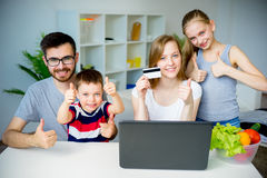 Family buying groceries online Stock Photography