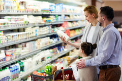 Family Buying Groceries in Store Royalty Free Stock Photo