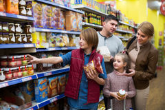Family buying groceries in supermarket Stock Photos
