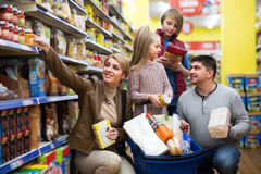 Family buying groceries in supermarket Stock Images