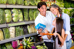 Family buying healthy food Stock Photos