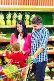 Family buying healthy food in supermarket Stock Image