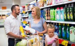 Family buying household goods Stock Image