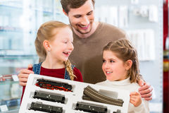 Family buying model railroad in toy store Royalty Free Stock Images