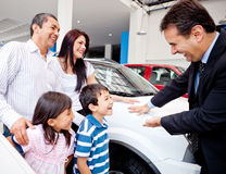 Family buying a new car Stock Photo