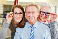 Family buying new glasses at. Happy family buying new glasses at optician retail store Royalty Free Stock Photography