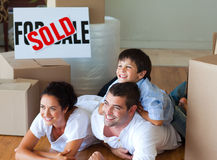 Family buying new house lying on floor. Happy family buying new house lying on floor stock photography