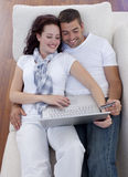 Family buying online with laptop Stock Image