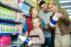 Family buying pasteurized milk in market Stock Photos
