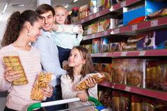 Family buying pastry in supermarket Stock Photo