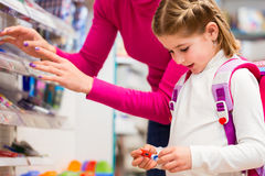 Family buying school supplies in stationery store Stock Photo